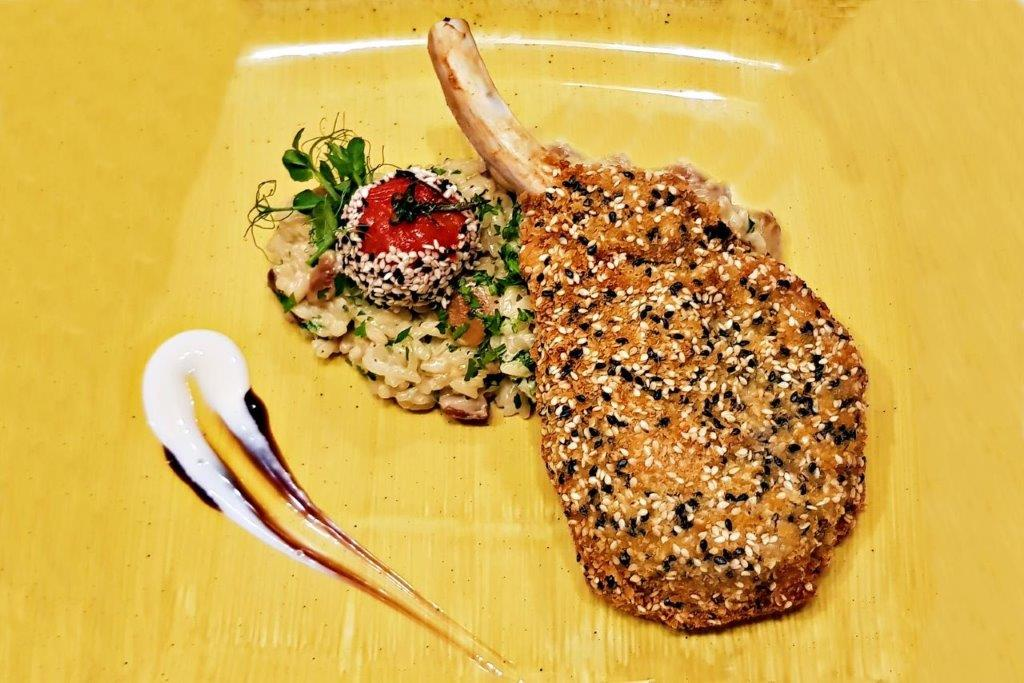 Sesame Crusted Pork Chop Served with Rice Cooked with Porcini Mushrooms